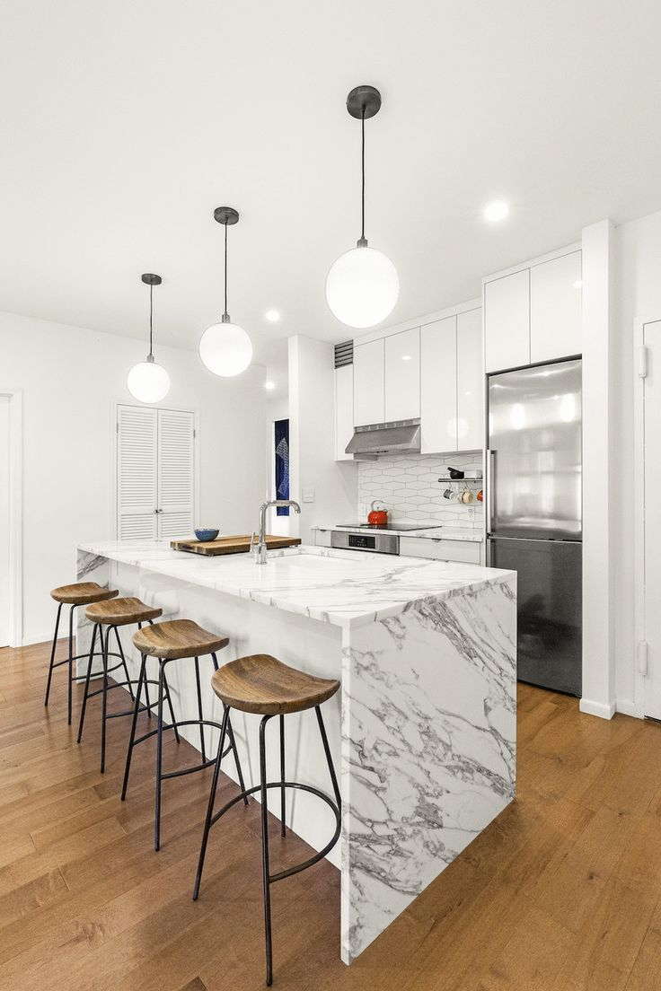 Sleek waterfall countertops made it onto our list of the top 10 renovation trends of the year (and wish list!). See the rest on the blog.