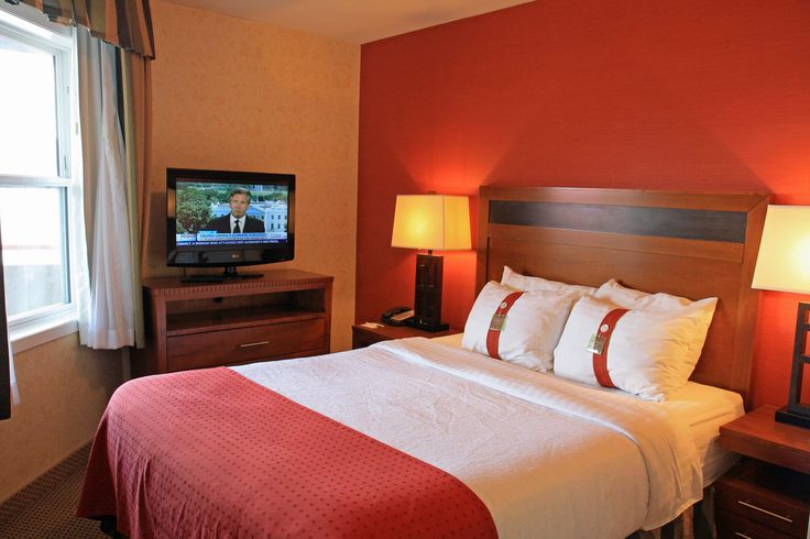 The master bedroom of our south facing business suites - starring a comfortable Queen bed.