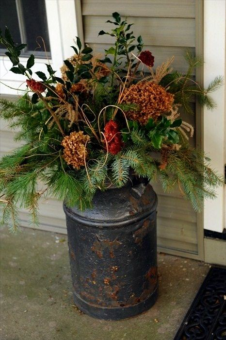I've been wanting some milk cans so bad! What a cute use for holiday decor!