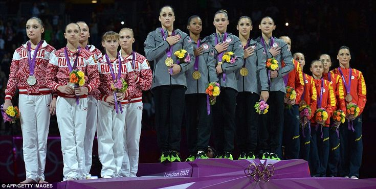 Pride: Team USA stands at the centre of the Olympic podium with silver medallists Russia, left, and bronze medallists Romania, right