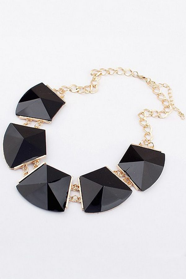 The bib necklace featuring faceted faux stone. Curbed chain. Adjustable clasp.