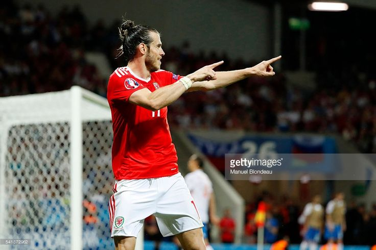 Gareth Bale celebrates scoring his goal during the UEFA EURO 2016 Group B match between Russia v Wales at Stadium Municipal on June 20, 2016 in Toulouse, France.