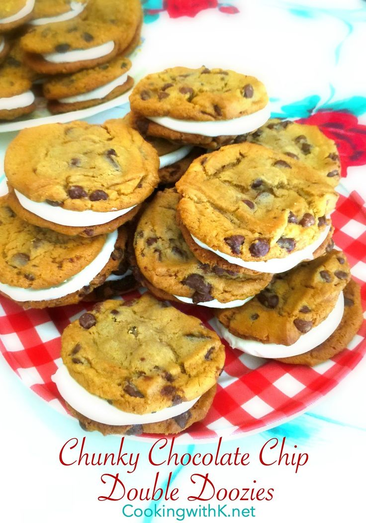 Chunky Chocolate Chip Doozies, fluffy frosting sandwiched between two giant soft and chewy, chunky chocolate chip cookies, a copycat of the beloved cookie found at the cookie store in your local mall.