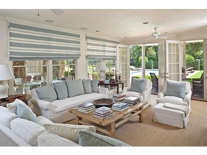 Sun Room With Linen Slipcovers French Doors And Blue White Striped Roman Shades On The Windows Beachy Feel By Carol Glasser