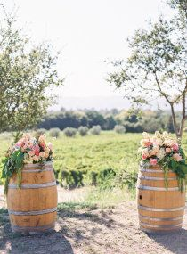 wine barrels overflowing with baby's breathe and roses maybe with snapdragons added in