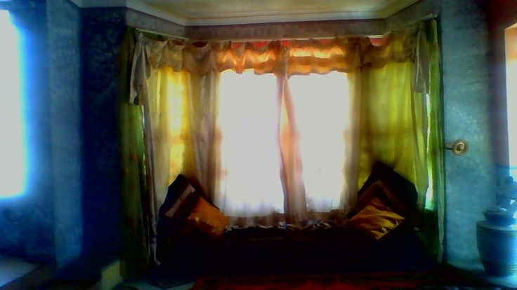 I made curtains & sitting of the bay window gold pillows.