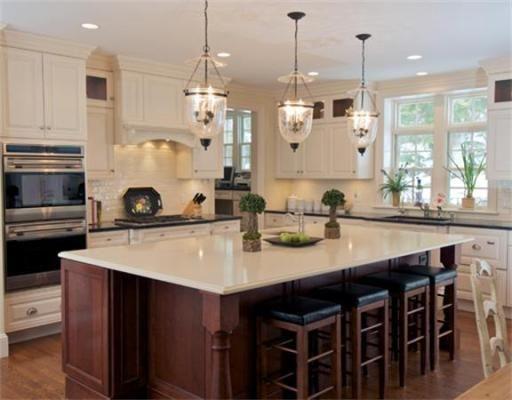 white kitchen dark island