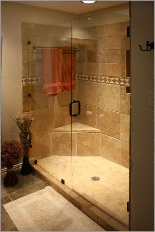 Stone shower with frameless glass