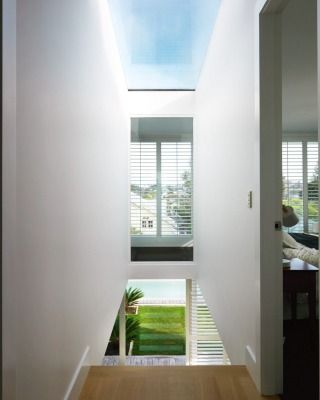 The vista from the front door through to the back of the house is uninterrupted, thanks to an interior window in the main bedroom.