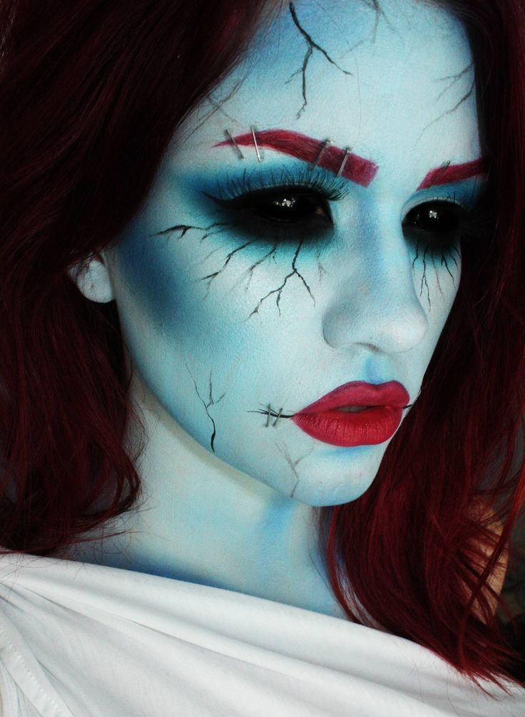 Interesting makeup, and fake staple effects over eyebrow and side of mouth.  This makeup effect goes great with our Black Sclera contact lenses => http://www.pinterest.com/pin/350717889705707881/