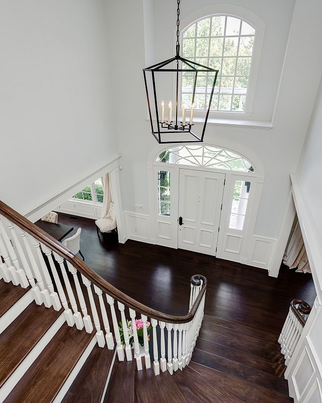 A stately lantern-style light fixture hangs above the home's two-story entry.