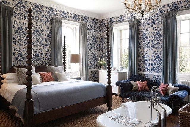Country bedroom with blue patterned wallpaper on HOUSE - design, food and travel by House & Garden. Babington house was decorated with comfort as the key aim.