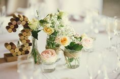 Cork Table Numbers & Flowers in Jam Jars wrapped in Twine | Outdoor Humanist Ceremony | Destination Wedding | Marry Me in France | Maison Mondou | Jenny Packham Wedding Dress | Eliza Claire Photography | http://www.rockmywedding.co.uk/rebecca-james/