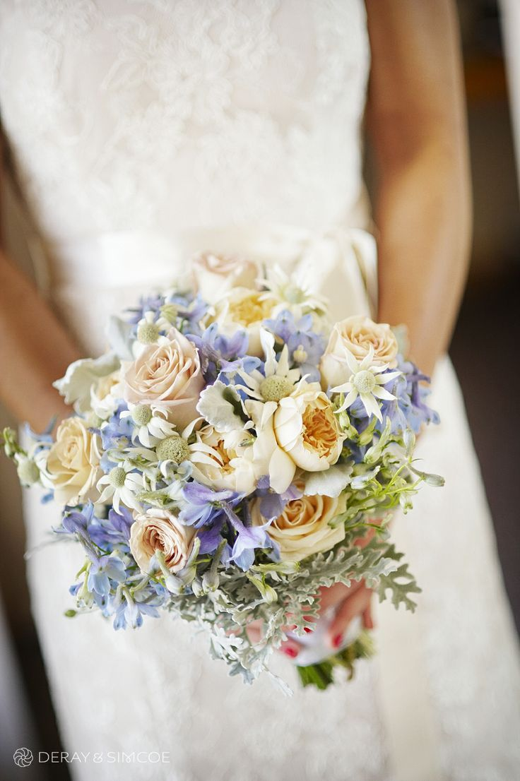 Peach rose bride's bouquet with accent of blue and grey. Photography by DeRay & Simcoe Bouquet by Creative Impressions