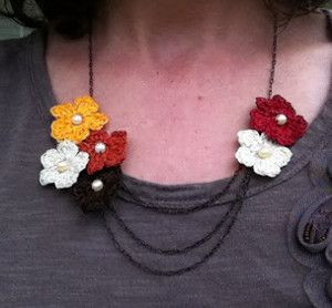The Fall Flowers Crochet Necklace incorporates all the colors of autumn. Reflect the fall palette in your wardrobe with this free crochet necklace pattern.