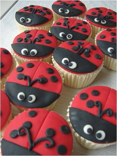 Ladybug cupcakes are a cute idea for kids birthday party.  Have you made black frosting?