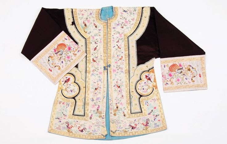 A Chinese Nonya wear jacket, late Qing Dynasty embroidered, woven and appliqued, with an elaborate design of birds, butterflies and flowers, gold thread borders