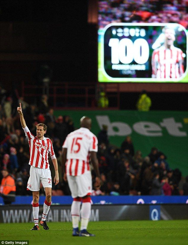The scoreboard at the bet 365 Stadium flashes up 100 Premier League goals for Peter Crouch...