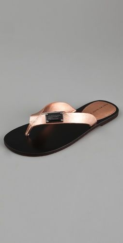 Marc Jacobs rose gold flip flops.