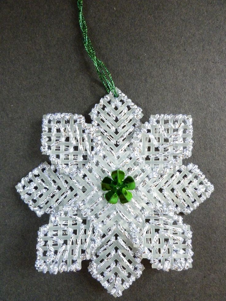 Christmas tree decoration made, using plastic Aida, embroidery thread and a flower sequin.   Nov. 1995.