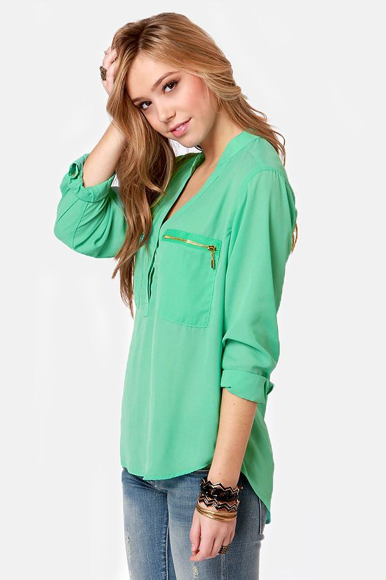 Redhead in sheer green blouse