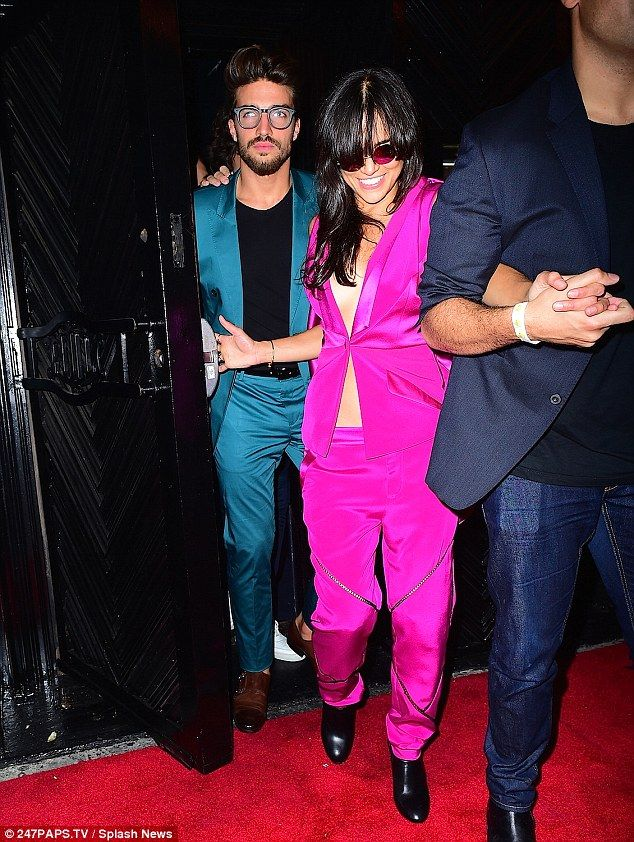 Make way:Michelle Rodriguez was spotted leaving the bash with an attractive male pal...