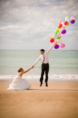Cute idea for a fun wedding photo on the beach or a dock at Green Lake, Wisconsin.