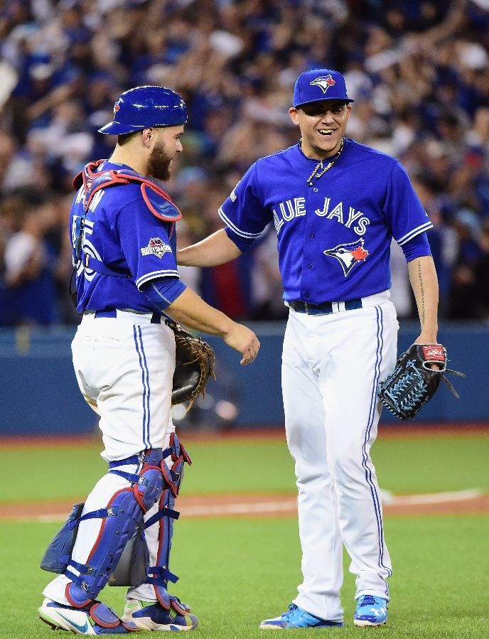 Russell Martin, Roberto osuna, TOR///Game 3 ,ALCS v KC, Oct 19, 2015  (Harry How/Getty Images)