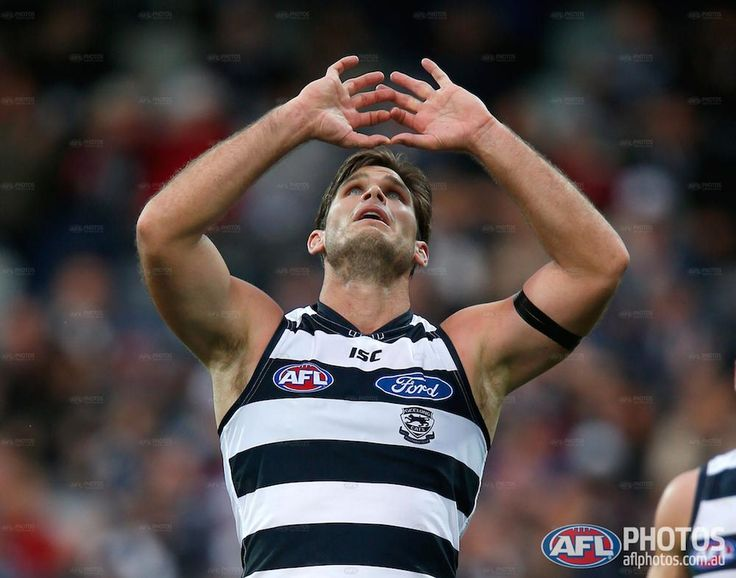 Round 4 - Tom Hawkins gestures to the sky to pay tribute to his late mother
