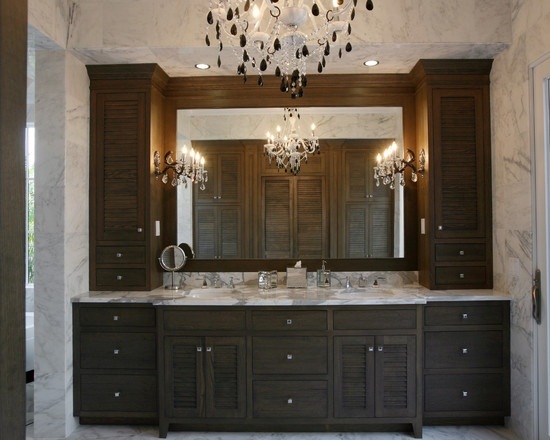 heres an example of recessed base cabinetry with custom mirror and sconces transitional bathroom traditional bathroom tampa campbell cabinetry