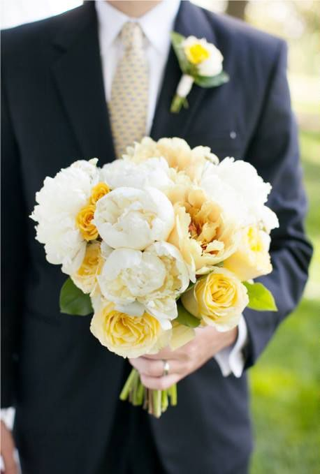 a dashing groom plus a sunshine yellow bouquet is the perfect combination for a happy wedding! see more beautiful work from Leigh Pearce Weddings here http://www.weddingchicks.com/vendor-guide/leigh-pearce-weddings/