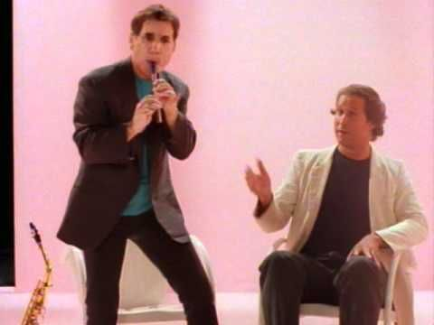 Paul Simon - You Can Call Me Al:  A great song and my favorite music video of all time