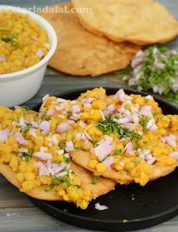 An extremely popular Sunday breakfast delicacy in Sindhi homes.  Chana dal served with crispy pakwans. The dal is thick, creamy and spicy. The pakwans, though the name sounds intimidating, use the same papadi dough rolled out into large chapatis and deep fried until crisp.  In order to obtain crispy unpuffed pakwans, always prick them before frying. It is also important to remember to fry them over medium heat so that they are crisp.