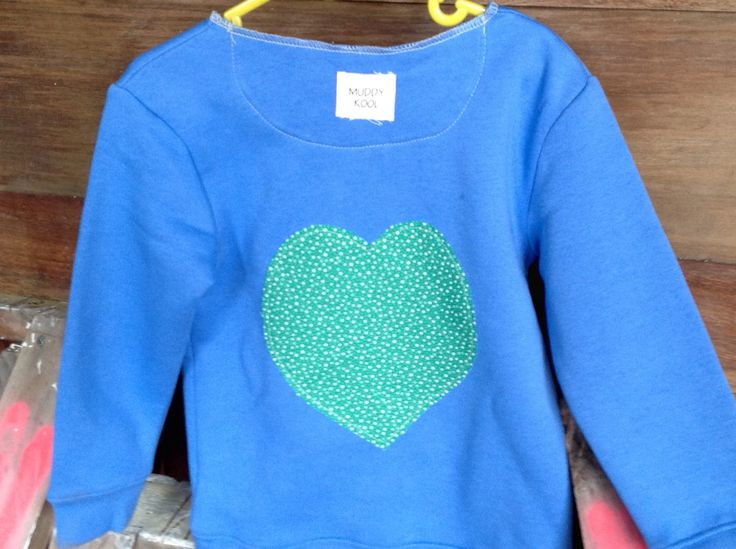 Upcycled fabric heart applique on the back