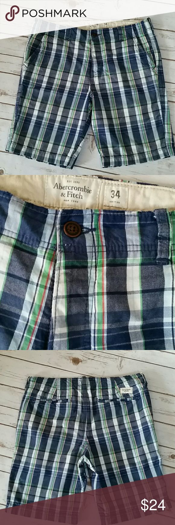 Abercrombie & Fitch Men's Plaid Shorts Awesome cotton, plaid shorts. Size 34, front & back pockets, button fly. Frayed/distressed edging, this is part of the design. Coloring of shorts is a navy, white, green & red. Very preppy style, heavier material, extremely well made. Like new, worn a few times, excellent condition. Abercrombie & Fitch Shorts