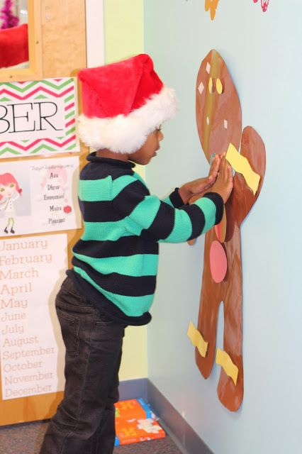Reinforcing body part awareness and decorating a life size Gingerbreadman! Great Fine Motor activity with velcro!