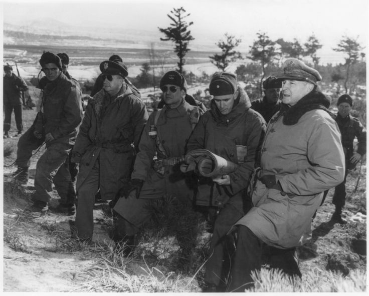 Douglas MacArthur at the front lines above Suwon, Korea, accompanied by Courtney Whtney, Matthew B. Ridgway, William B. Kean, and others (Jan. 28, 1951)