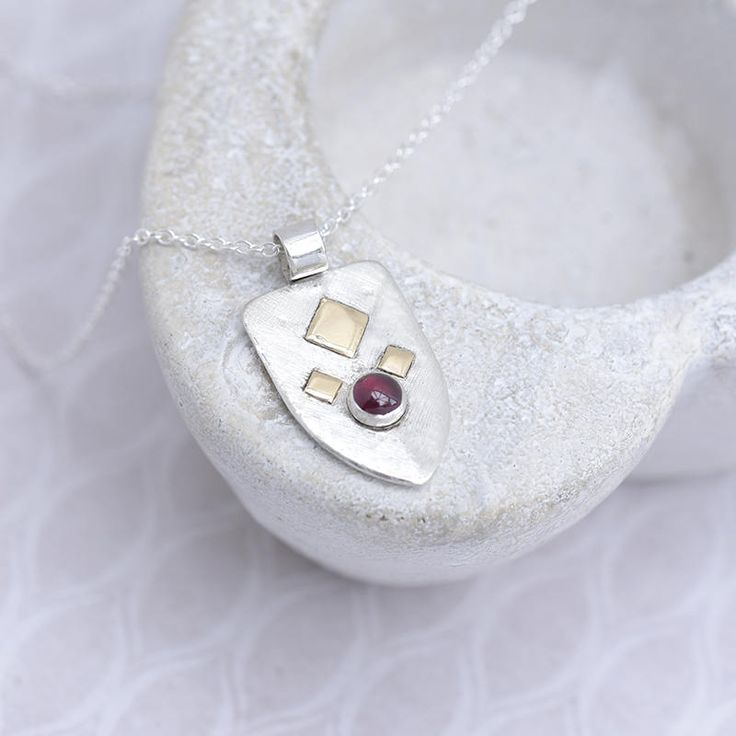 Sterling Silver Pendant with Garnet and Gold Decoration, Heraldic Style Garnet Pendant, Shield Shaped Garnet Necklace, Birthstone Pendant by ianaJewellery on Etsy