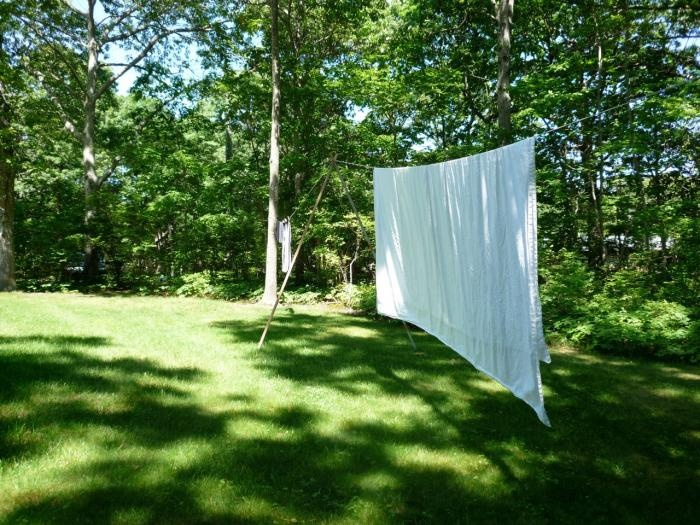 Interior designer Suzanne Shaker and art conservator Pete Dandridge designed their outdoor clothes line based on a childhood memory: a vision of white sheets blowing in the country wind.