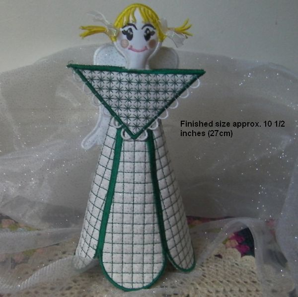 Beautiful 3D angel done in the hoop.  Back of dress got loops to enclose with buttons.  To create your own Angel, you can purchase the designs here http://www.oregonpatchworks.com/items.php?did=113482&pid=1588411