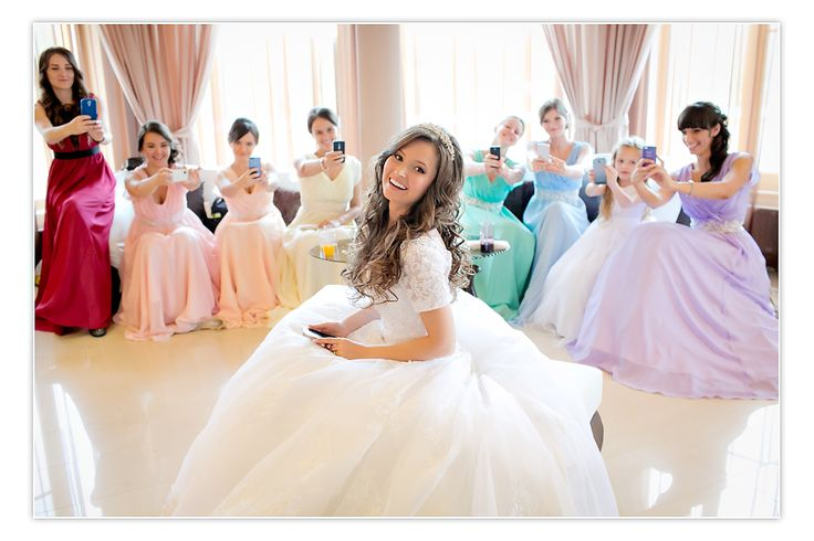 Rainbow bridesmaids dresses. Funny wedding photo!