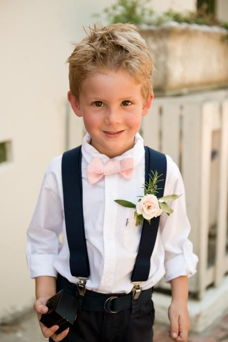Cute page boy with bow tie and cluster rose and olive boutonnière