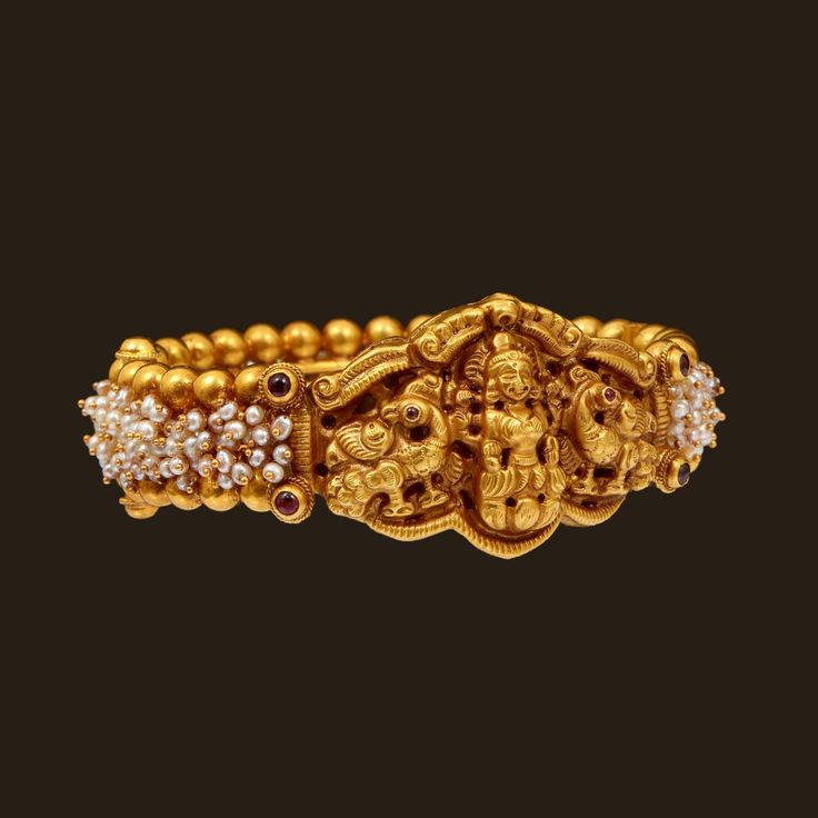 http://www.vummidi.com/store/product/447/gold-lakshmi-bangle-with-pearls