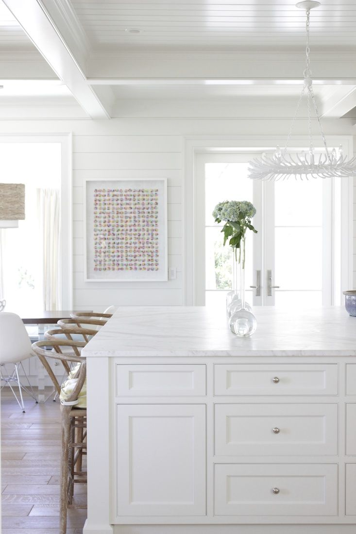 white kitchen design by Collins Interiors   unique vases and art by Phil Durst from blue print   blueprintstore.com