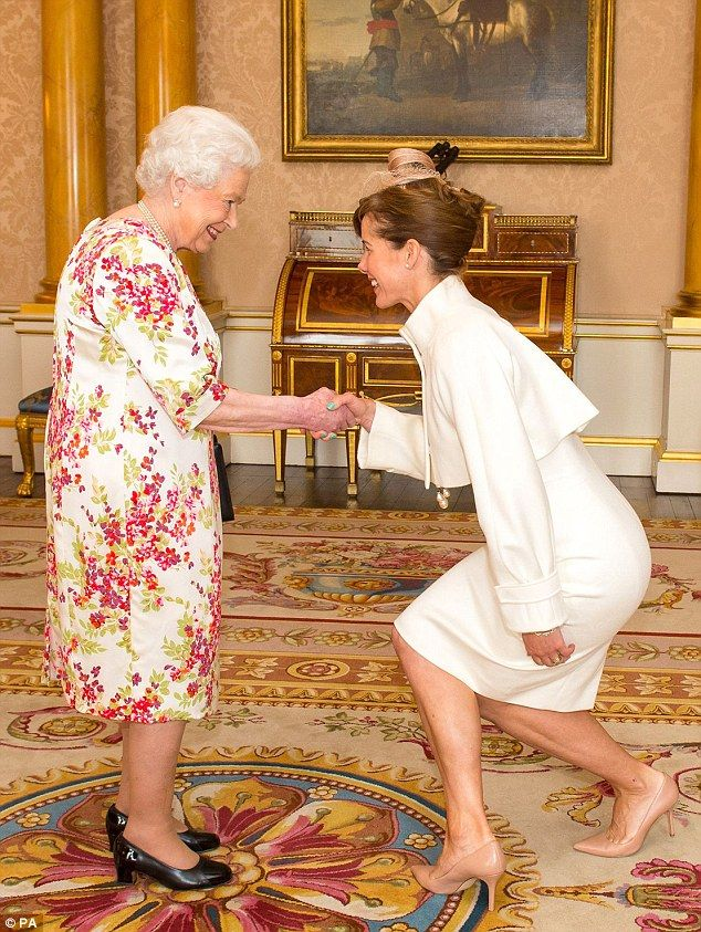 6/24/16*As she met a beaming Queen today, Strictly Come Dancing judge Darcey Bussell contorted her 5ft 5in frame almost to the ground – though still managed to return the monarch's smile