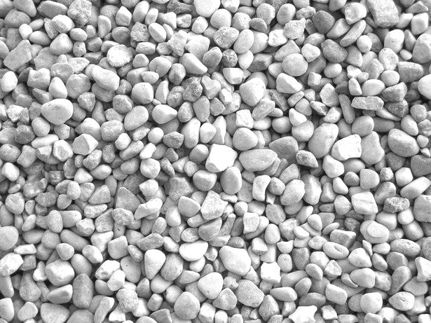 """Pea gravel, often used for driveways, paths, (or garden surfaces in general) is a versatile material with a lot of benefits: first of all, it's permeable, so water is absorbed and drains well through it. It's also soft, textural, and above all, inexpensive. The gravel is , well ,the size of peas (hence the name), and rounded in 1/8"""" to 3/8"""" dimensions and come in greys, tan, and white and sometimes a mix. To install, first use 2"""" of crushed rock below, and add 2-3"""" of gravel on top of ..."""