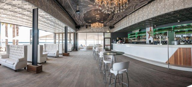 Lounge at Shimmy Beach Club, leading onto beach and Heineken Deck. 250 people standing or 80 seated. V&A Waterfront, Cape Town's premier  venue
