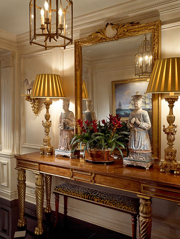 Sideboard, lantern, gilt mirror, lamps, leopard bench, red bromeliad plants - William Eubanks