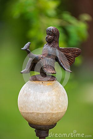 Garden decoration with a metal statue of a fairy