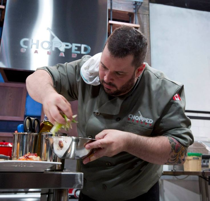 Chef Charles adds a little garnish to his appetizer.